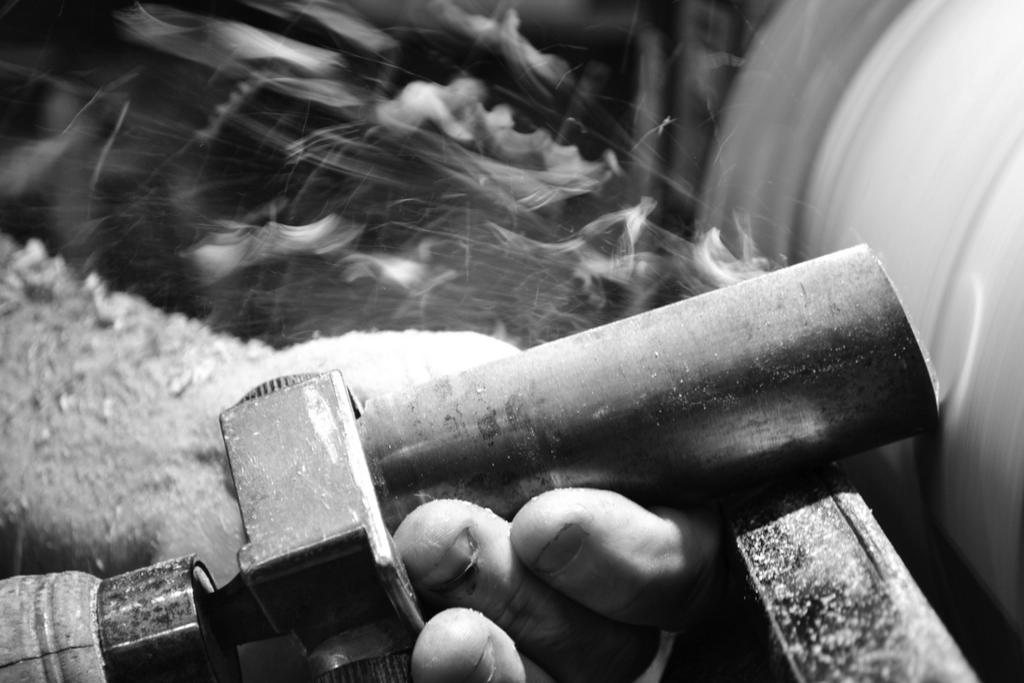 Turning drum shells on the lathe.